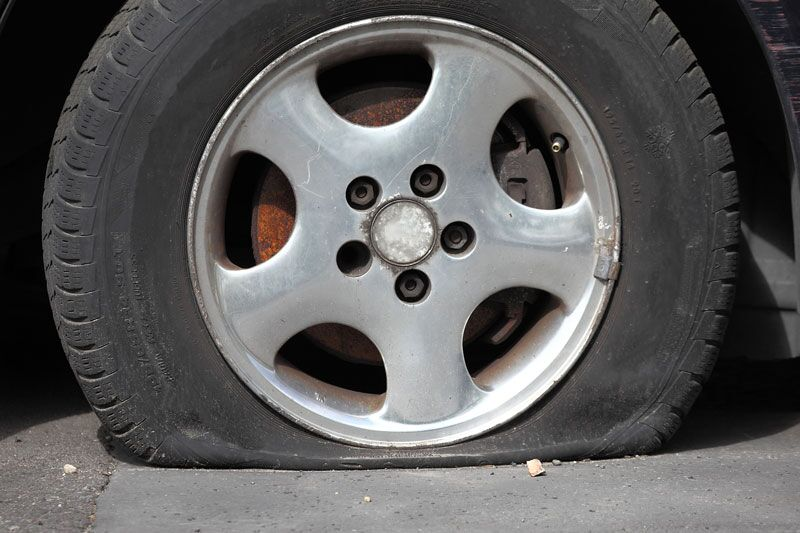 Steps to Take If You Blow a Tire While Driving, safely handle a popped tire while driving