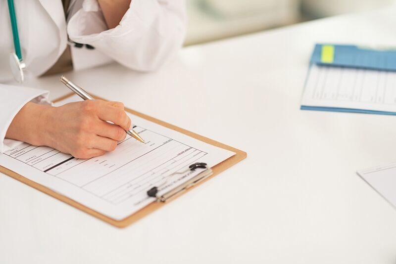 doctor filling out paperwork, supplemental health insurance
