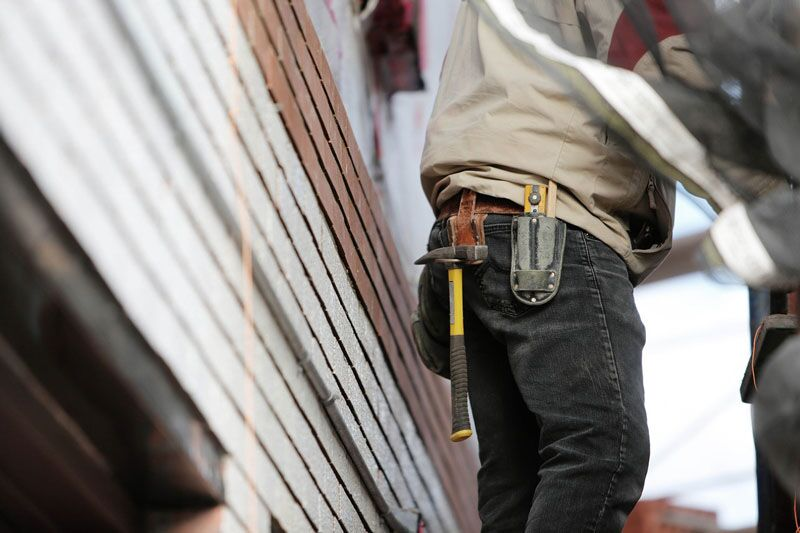 repairing the roof, don't procrastinate on these home repairs