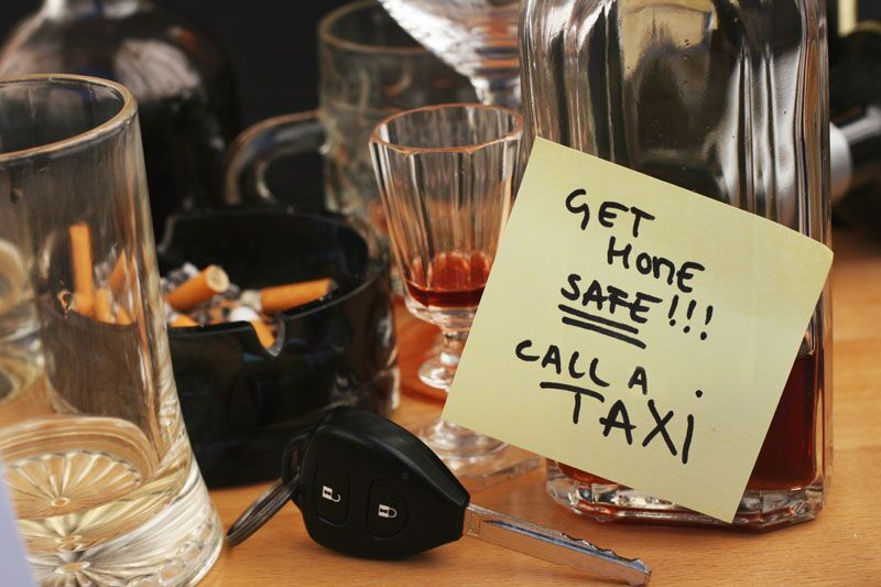empty drink glasses and a sticky note telling you to call a cab, how host liquor liability insurance can protect your business from party-related risks