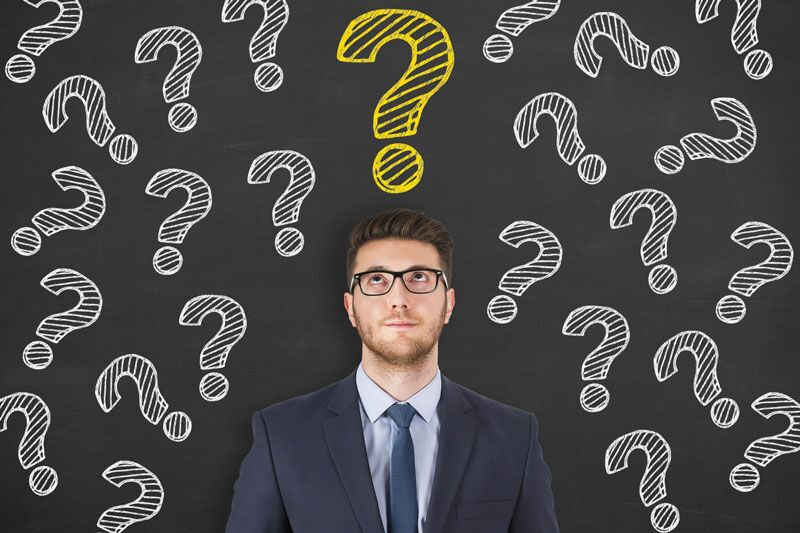 insurance agent surrounded by question marks, get the answers to these important auto insurance questions